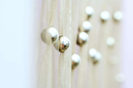 Modern yellow curtain with gold balls. photo