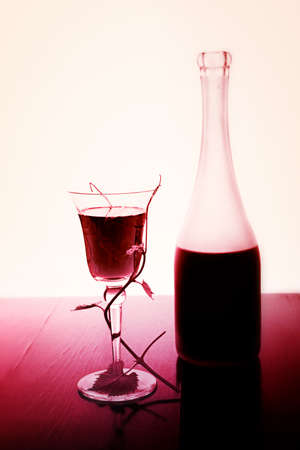 red wine glass and bottle isolated on white photo