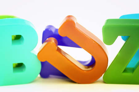 buzz: Close-up of letters. Buzz word. Stock Photo