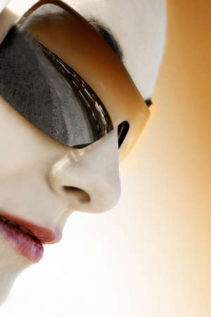 Closeup image of a beautiful girl face with sunglases. Reflection of the sea Stock Photo - 17605724
