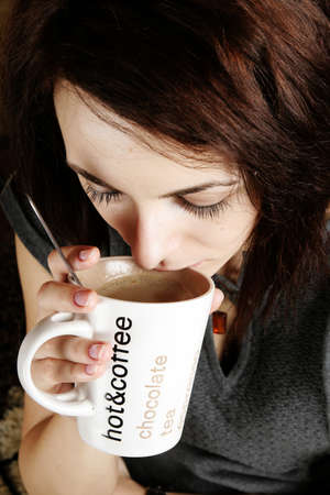 Beautiful woman drinking a cup of coffee Stock Photo - 17597189