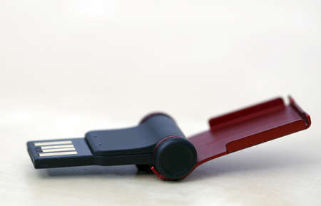 pliable: Close up of a red and small memory stick