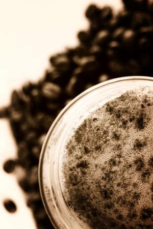 caffee: Latte Macchiato in glass costing on coffee grain Stock Photo