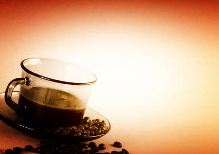 Cup with coffee, costing on coffee grain. photo
