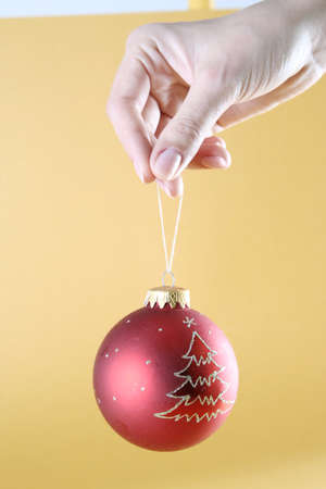 christmas ball isolated on yellow background. Stock Photo - 20859490