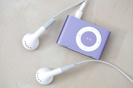 Modern and small mp3 player on a desk Stock Photo