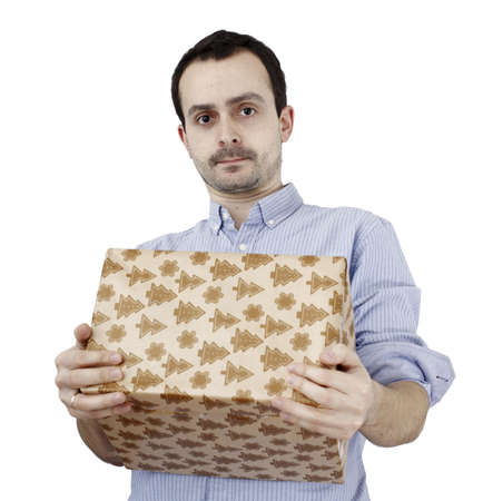 Young man holding a present in hands. photo