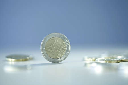 blurr: Close up photo of one euro coin on blurry