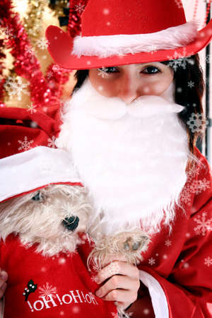 Santa claus with a white puppy in his arms.