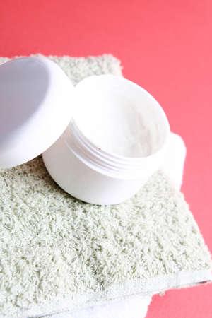 Moisturizing cream isolated on red Stock Photo - 23791589