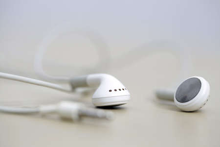 Modern and small earphones on a desk photo
