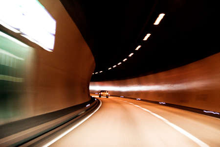 Car lights trails in a tunnel photo