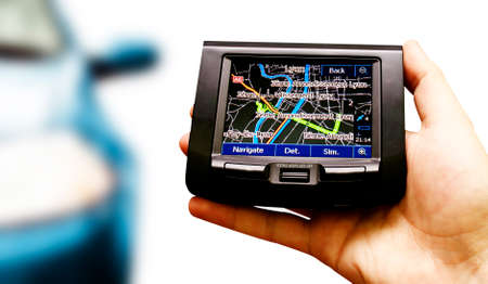 Gps in a man hand. Find your way ! photo