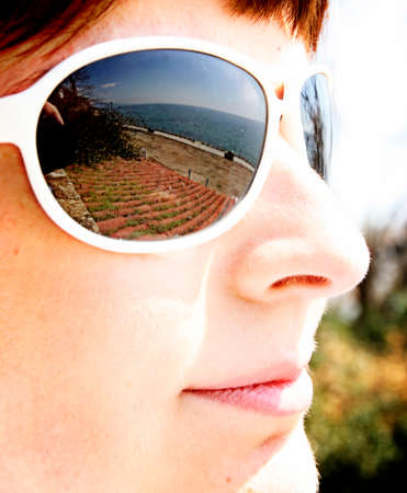 glases: Close-up of a woman face with sunglases.