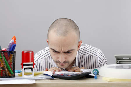 bald man: Young businessman at his desk