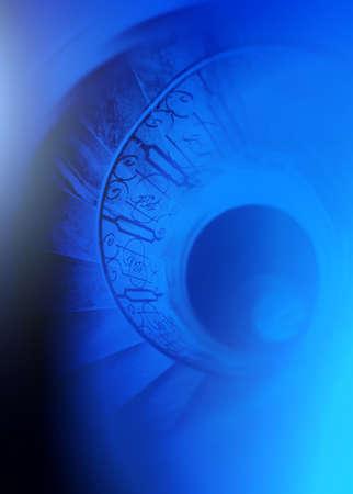 delirium: Very old spiral stairway case Stock Photo