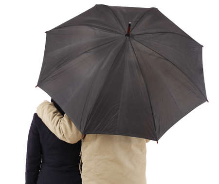 hidden danger: Couple with umbrella, isolated on white background Stock Photo