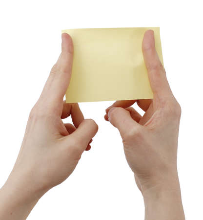 postit: One post it in a woman hand Stock Photo