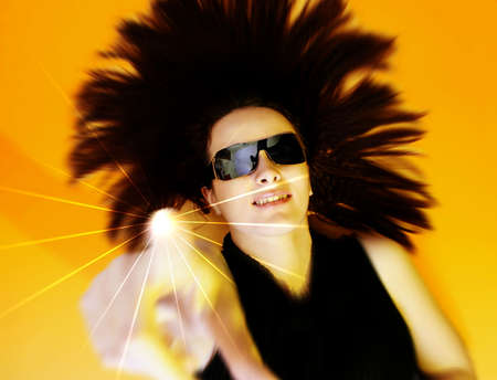 Beautyful woman with sunglasses isolated on orange background. photo