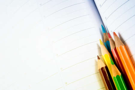 colored school: Close-up of color pencils and agenda