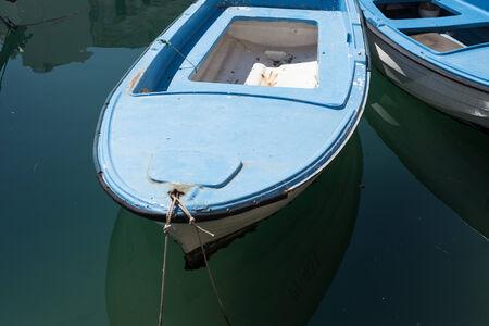 still water: Blue boat moored on still water in Piran Gulf Stock Photo