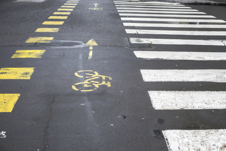 markings: Road markings showing bicycle path and pedestrian crossing Stock Photo