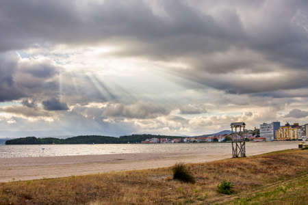 sunrays: Sunrays and clouds on Compostela beach