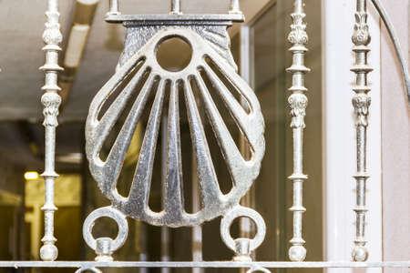 jacobean: Pilgrim Shell in cast iron fence Stock Photo