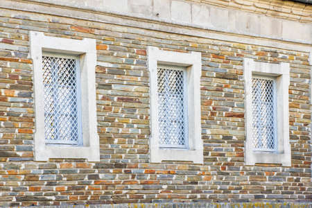 latticed: Three latticed windows on the wall in Lugo city