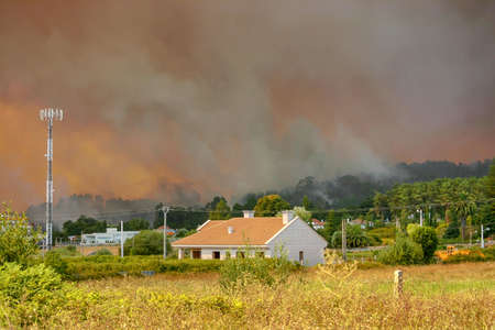 Houses of Vilagarcia de Arousa city surrounded by bushfire smoke in summer 2006