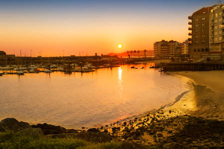 Panadeira beach and marina in Sanxenxo city at sunset