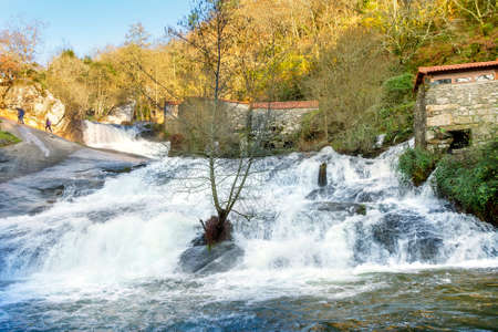 watermills: Waterfall and watermills of Barosa river in Barro town