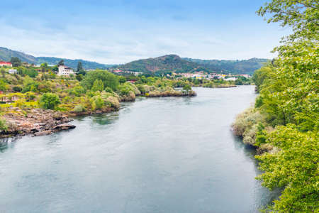 Water and vegetation of Minho river  as it passes through Ourense