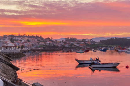 Naval fishing port in Arousa Island at red sunset Stock Photo