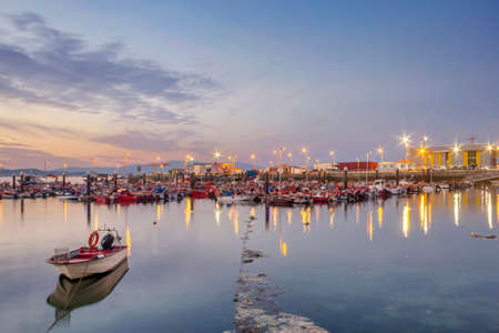 Boats moored on Xufre fishing port at night in Arousa Island Stock Photo