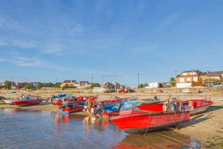 Fishing boats anchored on Abilleira beach in Arousa Island