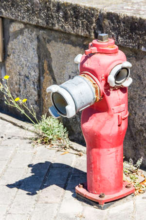 fireman: Red fire hydrant on a city street