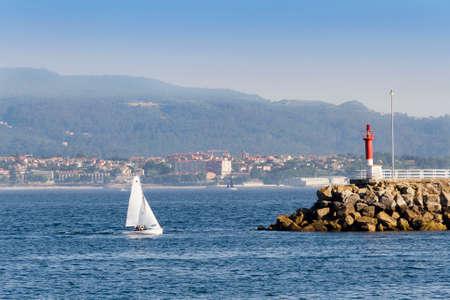 Sailboat entering Cangas de Morrazo port