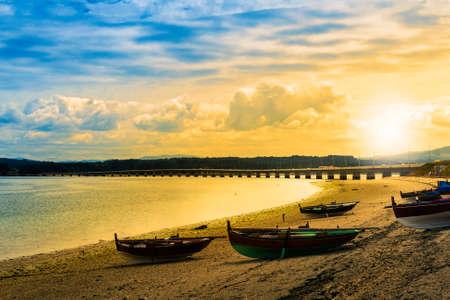 Dorna boats on the beach and bridge at dawn in Arousa Island