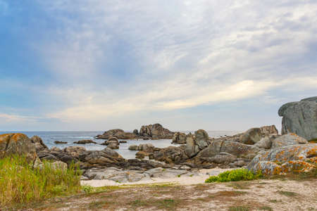 Dune and coastal rocks on Con Negro beach in San Vicente, O Grove town