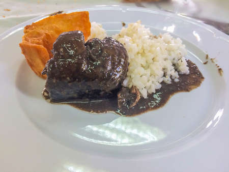 Lamprey on bordeaux sauce with rice and crotons
