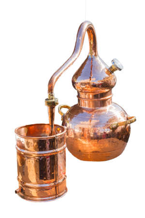 Copper alembic for schnapps production in white background Banque d'images