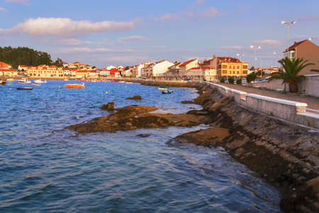 Cantinho seafront and boardwalk in Arousa Island at twilight
