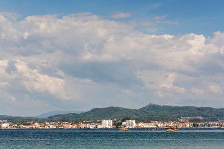 Vilanova de Arousa  under Lobeira mount and summer cumulonimbus Stock Photo
