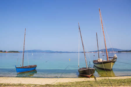 Three traditional wooden sailboats on the beach in Arousa Island, Galicia, Spain