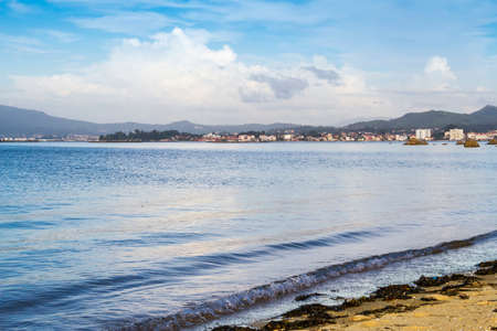 Vilanova village in Arousa bay from Aguiuncho beach in Arousa Island