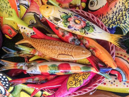 Colorful ceramic fish, souvenir for sale in Valenca do Minho, Portugal