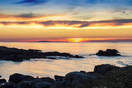 Arousa estuary mouth at golgen sunset from the rocky coast of Arousa Island