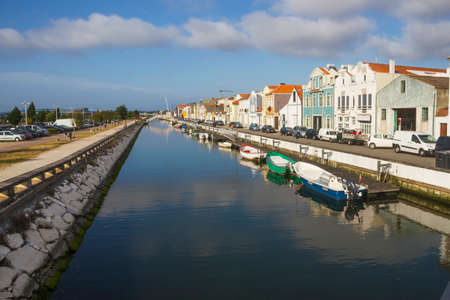 Navigable canal and lined houses and boats in Aveiro, Portugal