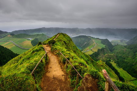 Panoramic landscape overlooking three amazing ponds, Lagoa de Santiago, Rasa and Lagoa Azul, Lagoon Seven Cities.The Azores are one of the main tourist destinations in Portugal